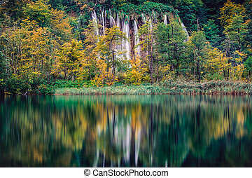 Waterfall lake reflection