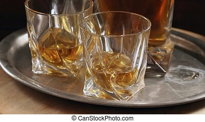 Set of glasses with whiskey on vintage tray