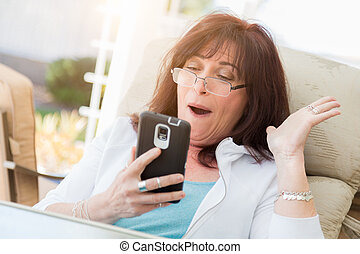 Shocked Middle Aged Woman Gasps While Using Her Smart Phone