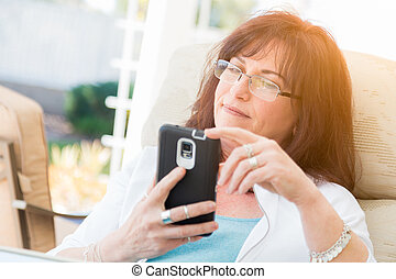 Attractive Middle Aged Woman Using Her Smart Phone