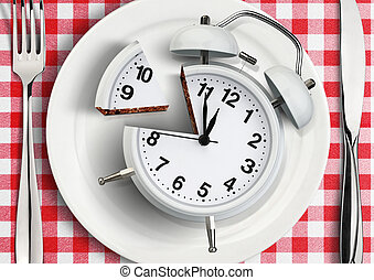 Time to eat concept, cut clock on plate. top view - Time to...