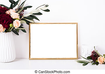Golden frame mock-up on white wall background, home decor...
