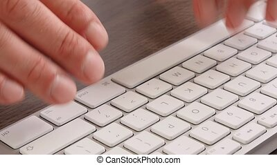 Extreme close -up businessman typing keyboard - Extreme...