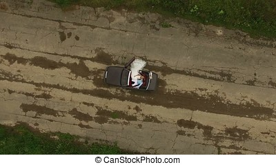 Cabriolet car wedding view from top aerial