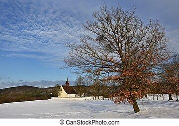 Winter landscape with a beautiful chapel near castle Veveri....