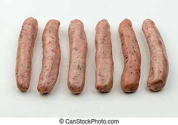 Chipolata sausages - Six raw chipolata sausages ready to be...