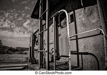 Caboose (Sepia) - A caboose sitting on the tracks in...