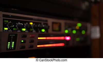 Close up of LED lights flashing on an audio equipment