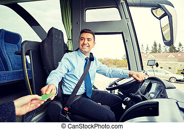 bus driver taking ticket or card from passenger - transport,...