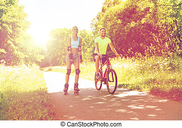 happy couple with rollerblades and bicycle riding