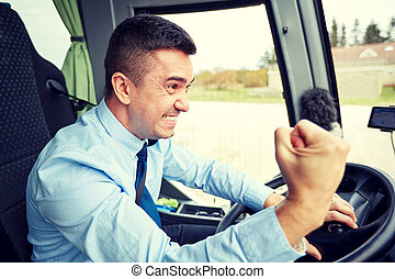 angry driver showing fist and driving bus - transport,...