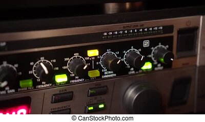 Tuning controls on a sound equipment. Handheld shot