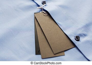 close up of shirt with price tag - clothes, fashion, formal...