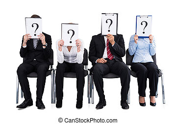 Businesspeople Holding Question Mark Sign - Businesspeople...