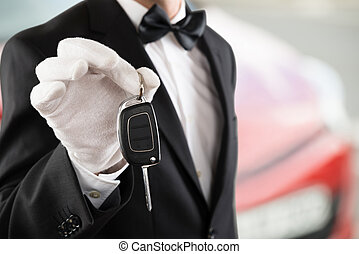 Valet Boy Holding A Car Key - Close-up Of A Valet Boy...