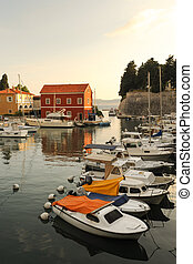 Picturesque Zadar at sunset - Zadar city walls and boats in...
