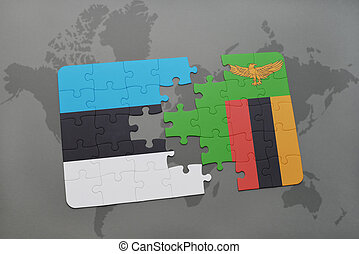 puzzle with the national flag of estonia and zambia on a...