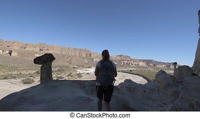 Backpacker Girl exploring Wahweap Hoodoos near Kanab -...