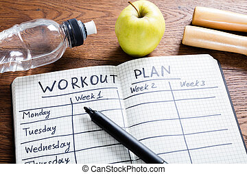 Workout Plan In Notebook - High Angle View Of A Workout Plan...