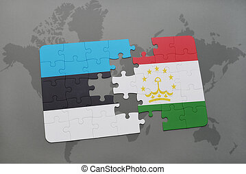 puzzle with the national flag of estonia and tajikistan on a...
