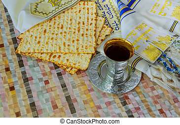 Jewish traditional Passover unleavened bread and a wine cup...