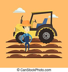Farmer standing with tractor on background. - Asian happy...