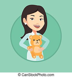 Pediatrician doctor holding teddy bear. - Pediatrician...