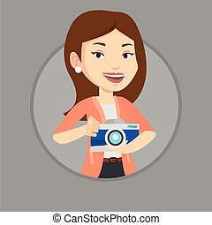 Photographer with camera in photo studio. - Caucasian...