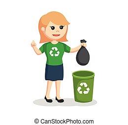 woman environmental activist put litter to bin