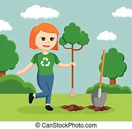 woman environmental activist planting tree