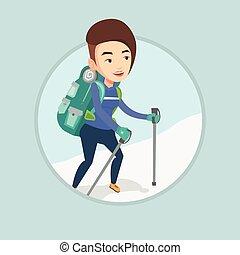 Young mountaneer climbing a snowy ridge. - Caucasian...
