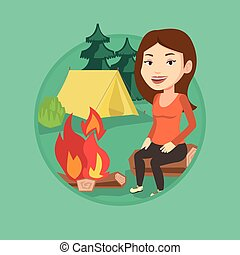 Woman sitting on log near campfire in the camping. - Woman...