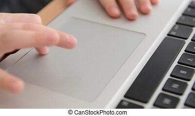 Smart kid playing on a laptop
