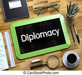 Diplomacy Handwritten on Small Chalkboard. 3D. - Small...