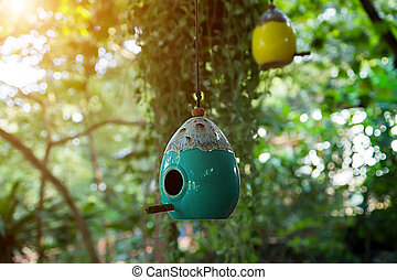 Bird houses made of ceramic in the garden.