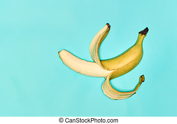 Single banana against blue background - Single fresh...