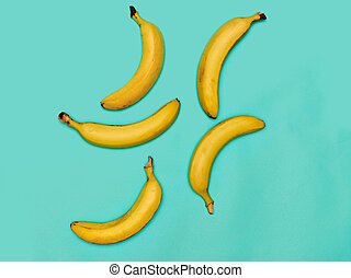 The group of bananas against blue background - The group of...