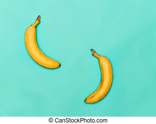 The two bananas against blue background - The two fresh...
