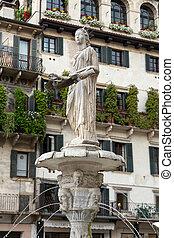 the Fountain of Madonna Verona in Piazza delle Erbe. Verona,...