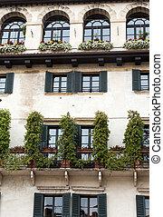 Facade of an old building at Piazza della Erbe in Verona....
