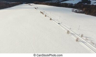 Car on winter road. Winter landscape. - Car on winter road...