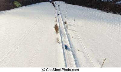 Car on winter road. Winter landscape.