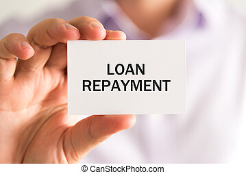 Businessman holding card with text LOAN REPAYMENT - Closeup...