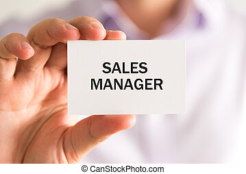 Businessman holding SALES MANAGER card - Closeup on...