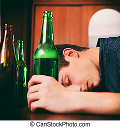 Young Man sleep with the Beer - Toned Photo of Tired Young...