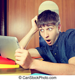 Surprised Young Man with Tablet - Toned Photo of Surprised...