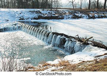 weir in winter - partly frozen weir on Odra river, Czech...
