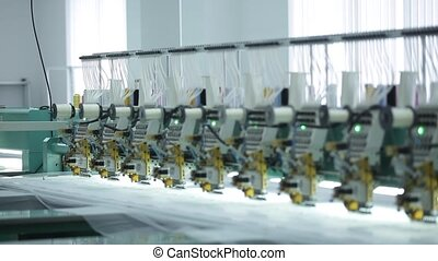 Textile industry with knitting machines in factory.