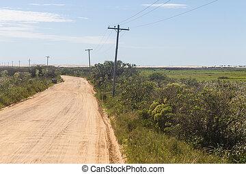 Road and Swamp at Lagoa do Peixe lake - Dirty road and...