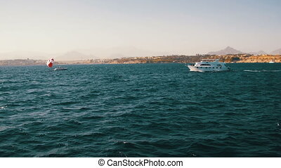 Pleasure Boat Floats on the Waves of the Red Sea on the Background of Coast and Beaches in Egypt